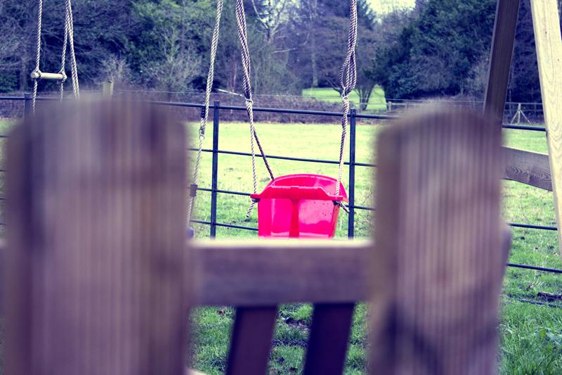 A swing set in the garden