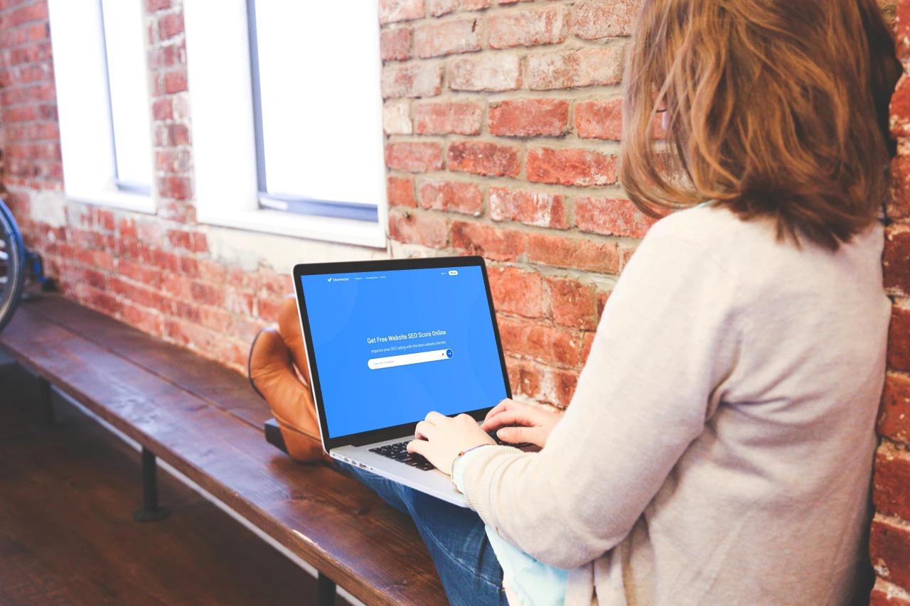 Person on laptop viewing sitecheckerpro