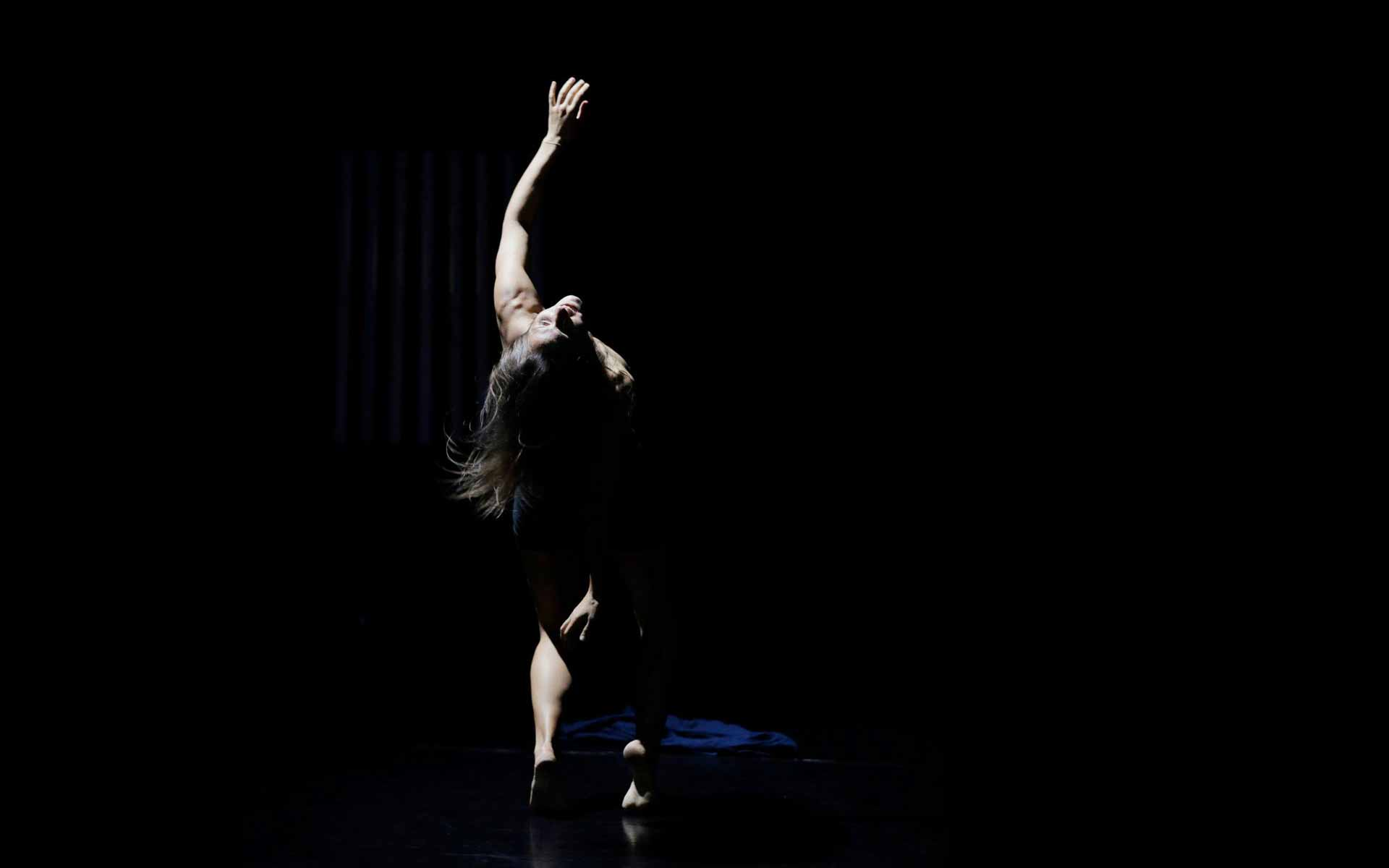 Dancer Anna Kempin stricking a modern dance pose, during her dance performance called InBetWeEn A Shock