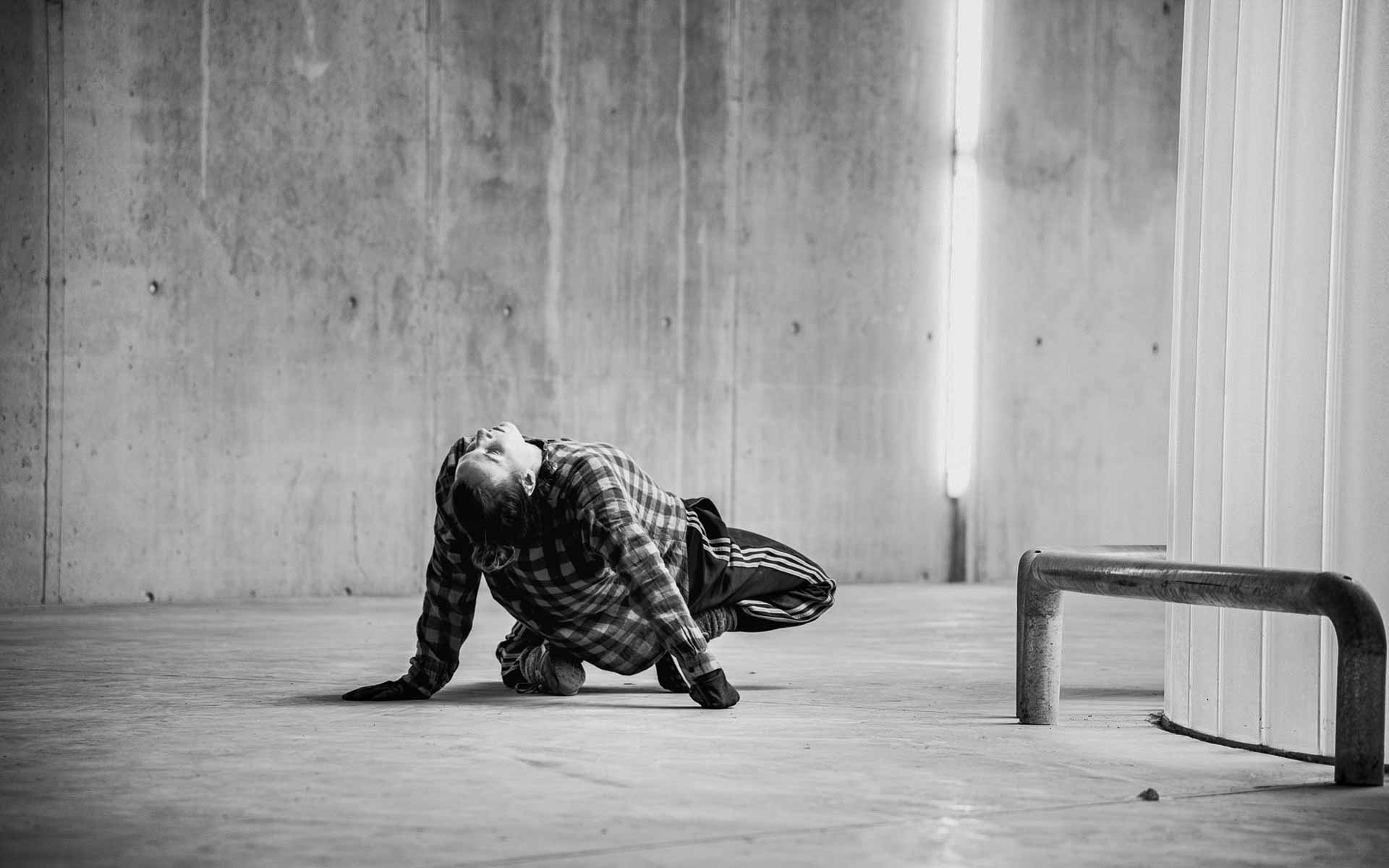 Dancer Anna Kempin showing contemporary dance floorwork during a performance