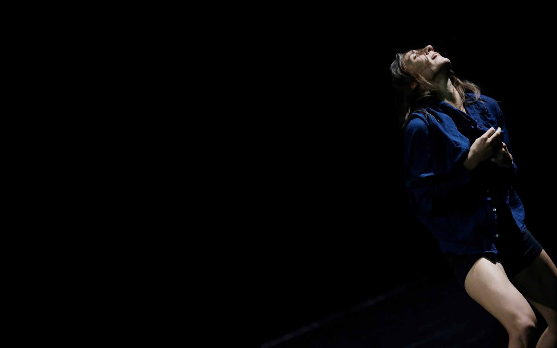 Dancer Anna Kempin buttoning her shirt during her InBetWeEn A Shock dance performance at Center for Contemporary Dance