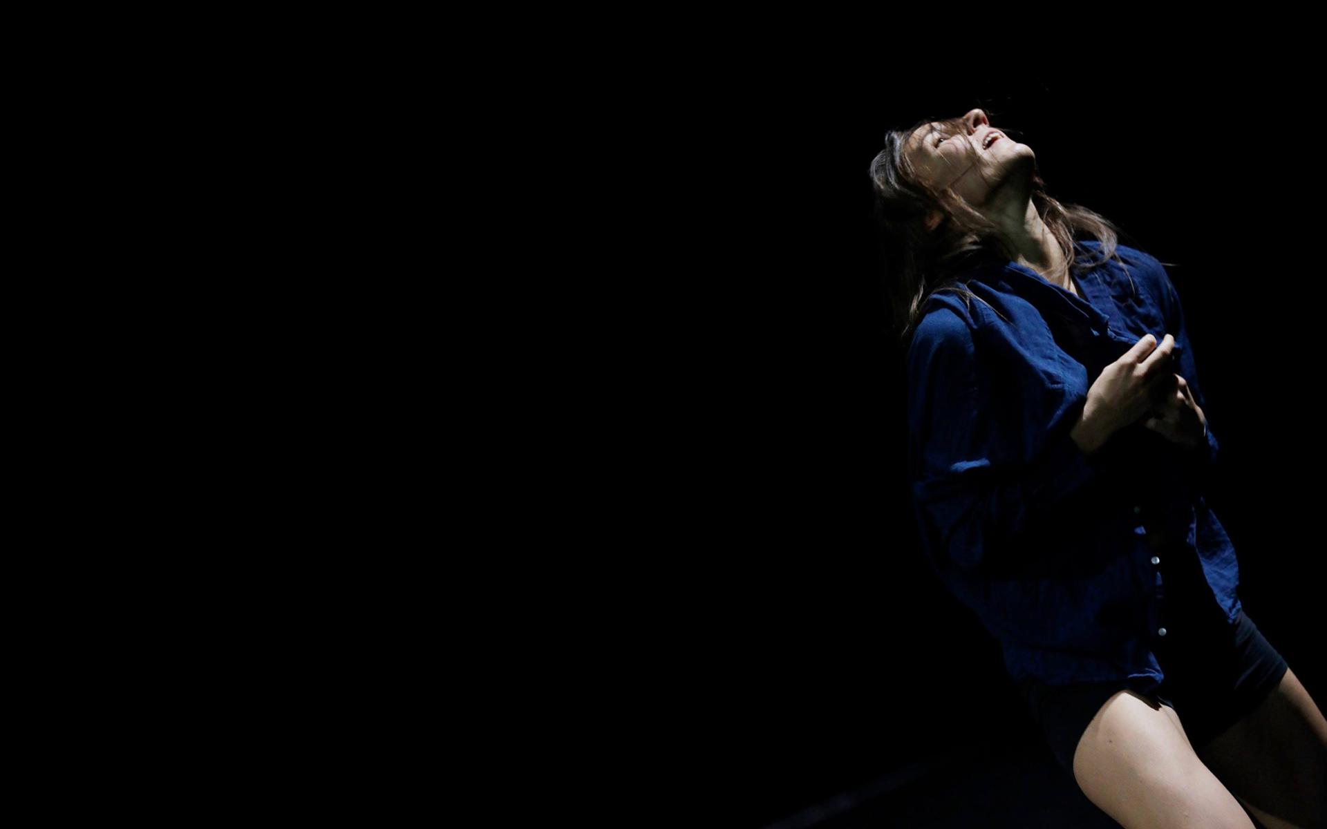 Dancer Anna Kempin buttoning her shirt during her InBetWeEn A Shock dance performance at Center for Contemporary Dance