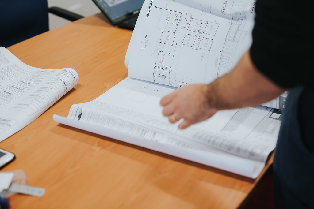 Electrician looking through documentation in office.