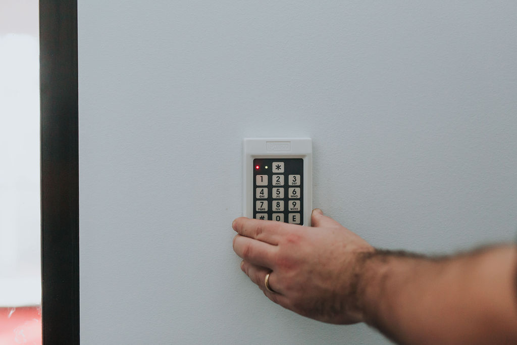 Electrician installing a security keypad door entry system