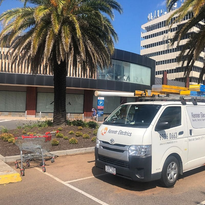 Electrician van parked at Westfield Doncaster Shopping Centre with palm tree