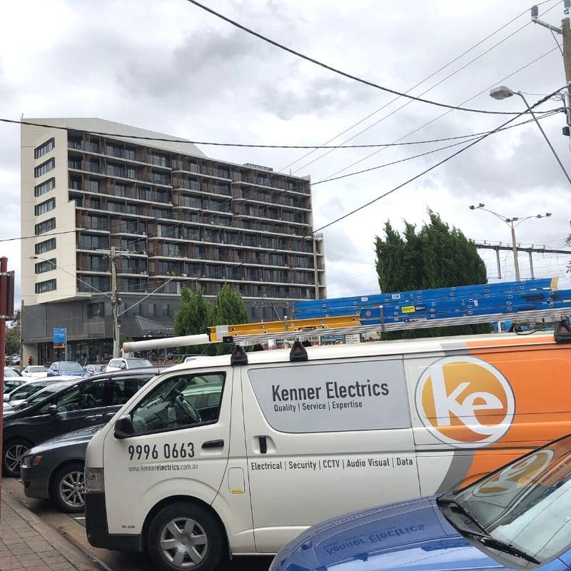 Kenner Electrics electrician van in front of apartments in Glen Waverley