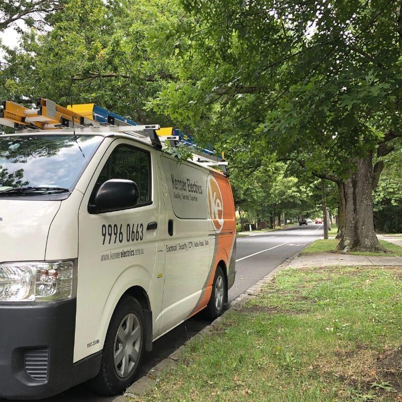 Kenner Electrics van parked in leafy street in Surrey Hills