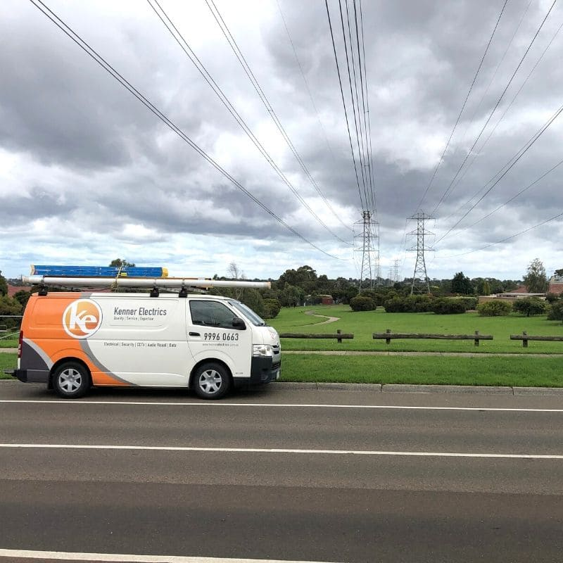 Kenner Electrics van driving past overhead electricial cables in Mount Waverley