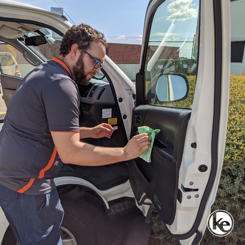 Electrician disinfecting their work vehicle during COVID pandemic