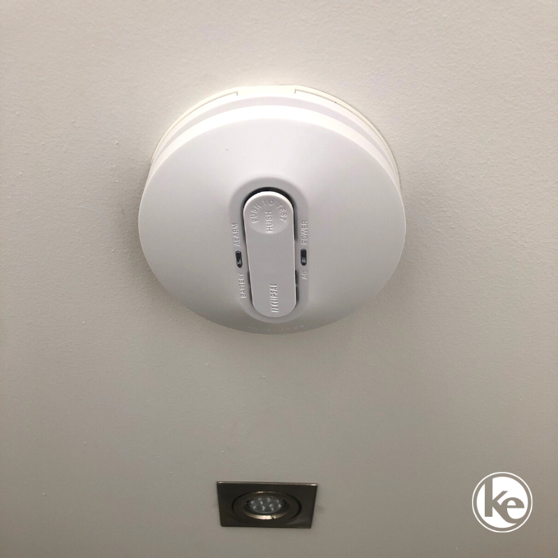 Photoelectric smoke alarm installed to detect fire