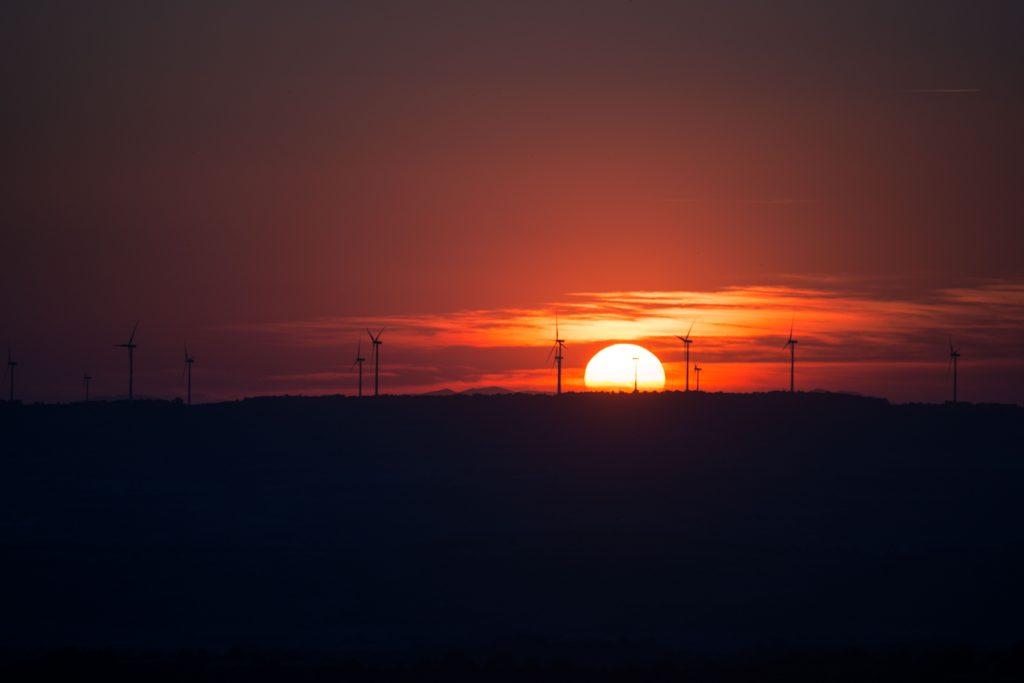 Orange sunset over horizon with telephone poles