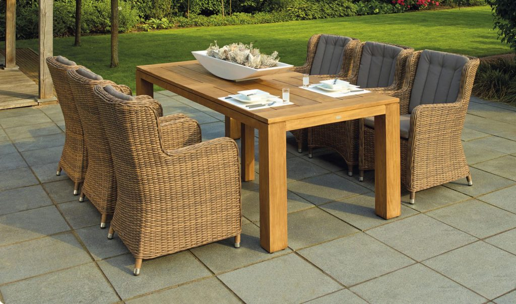 Outdoor patio furniture with six chairs and a table