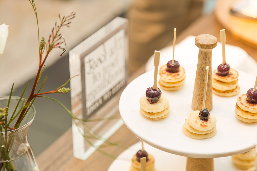 Mini blinis with a berry compote on skewers