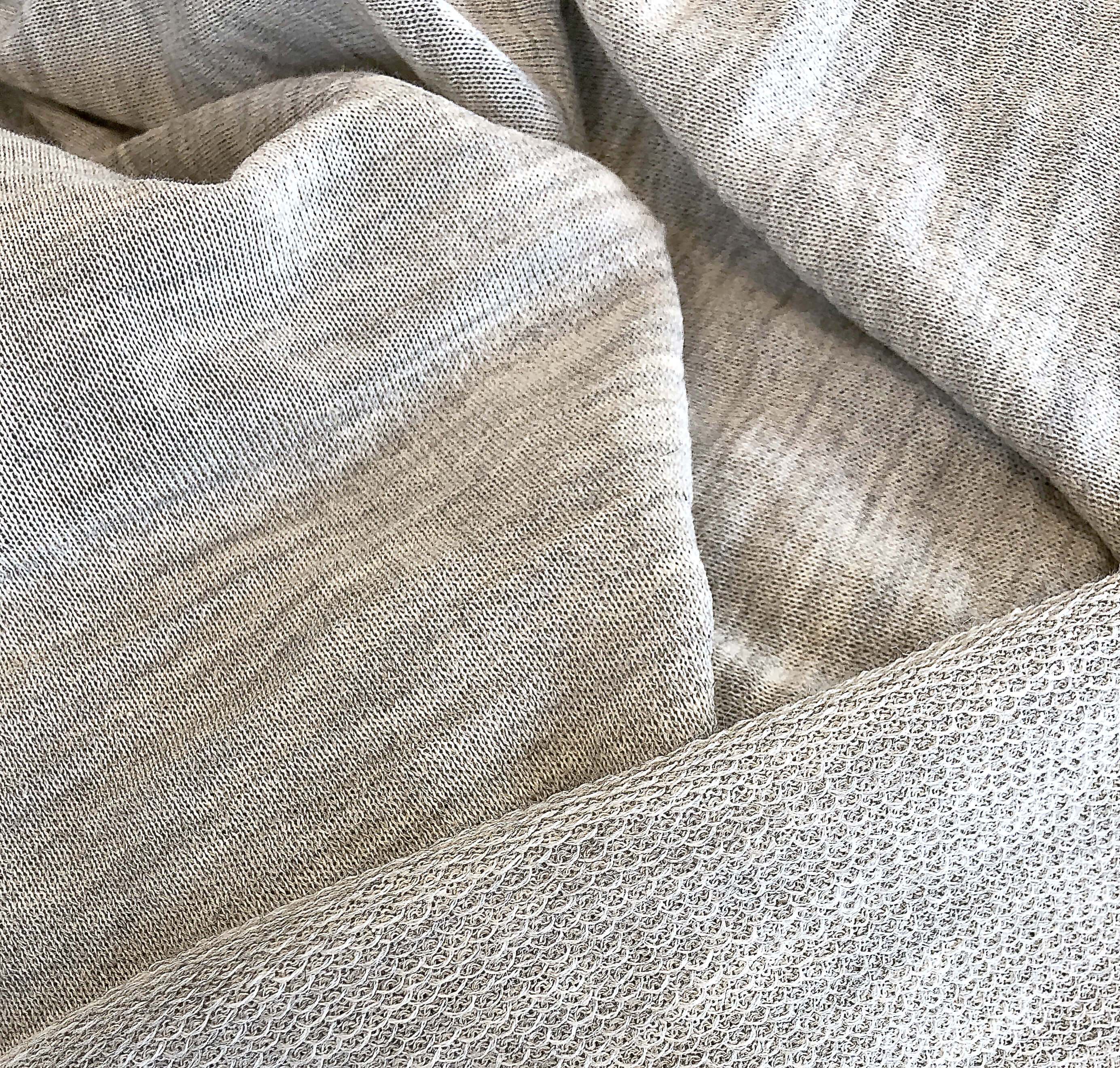 Close up of pieces of woollen jersey fabric from the outside and the inside which demonstrates an intricate loop pattern
