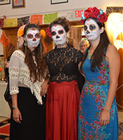 Women dressed up in Day of the Dead celebration attire