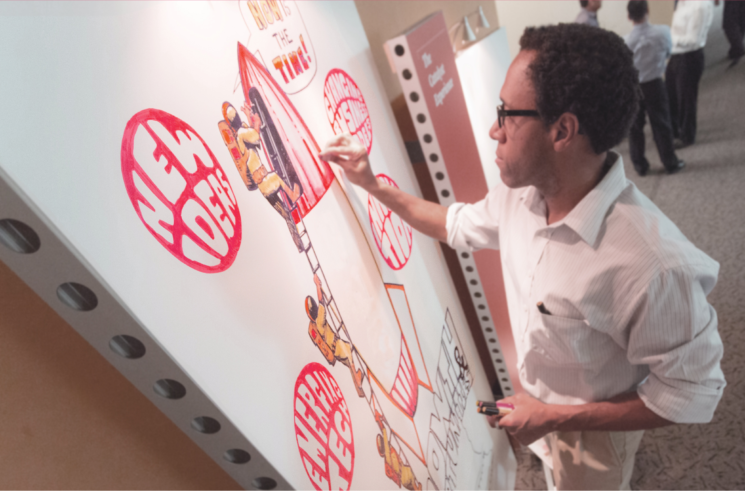Christopher Fuller, CEO and Chief Scribe of Griot's Eye drawing a rocket ship while graphic recording