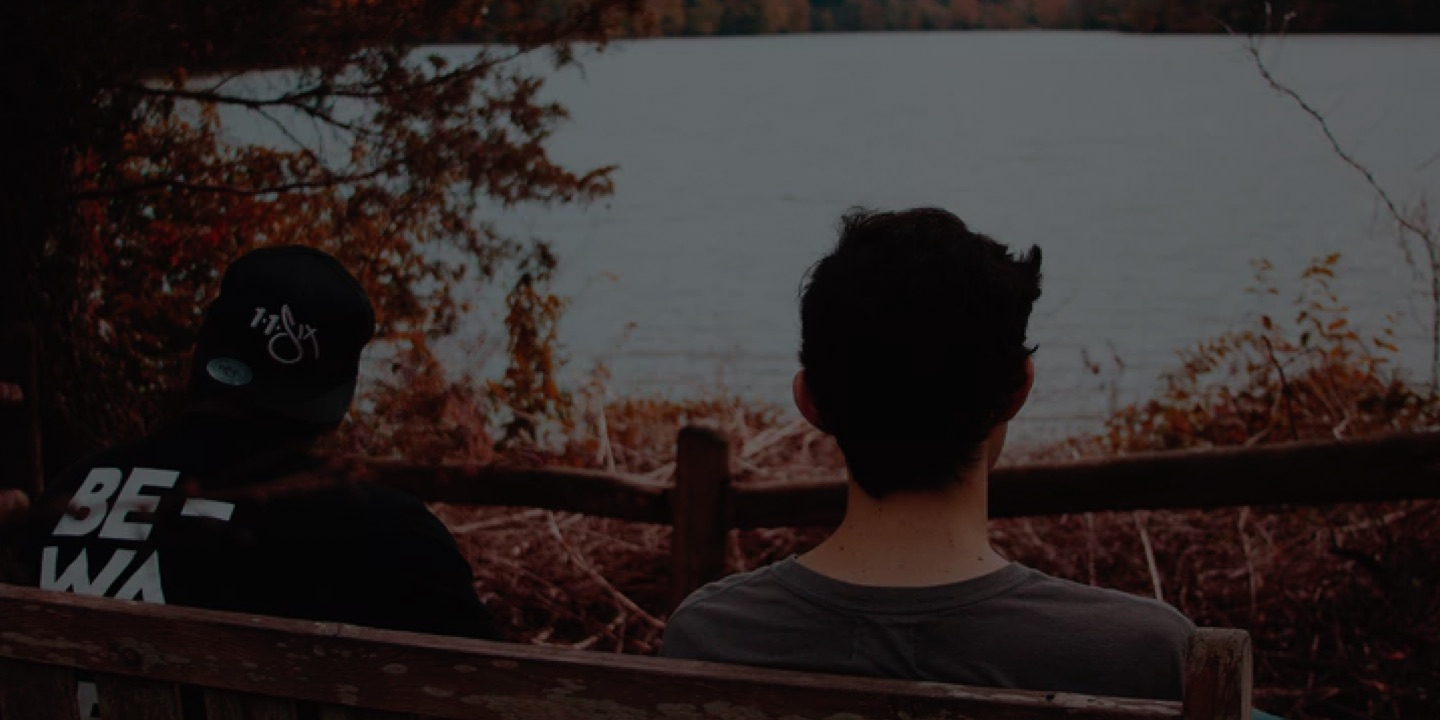 Two men looking out over water
