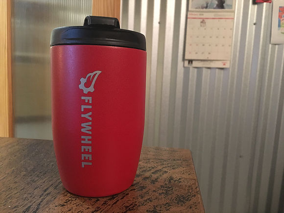 Thermos with the Flywheel logo printed on it