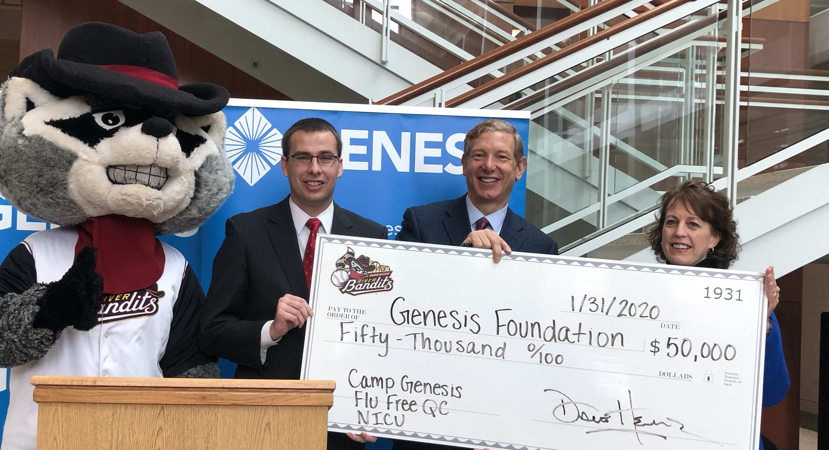 Dave presenting a check supporting the Genesis Foundation