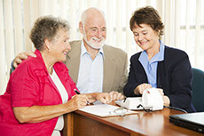 Accountant sitting with an elderly client couple