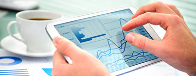 Tablet with financial graphs - Business Consulting Chicago