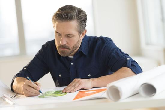 Architect working on design blueprints