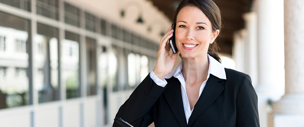 International tax accountant on the phone with her client.