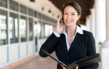Businesswoman talking on a phone with her client