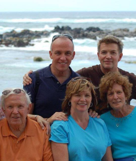 Eddie with his brother, dad, sister, and mother