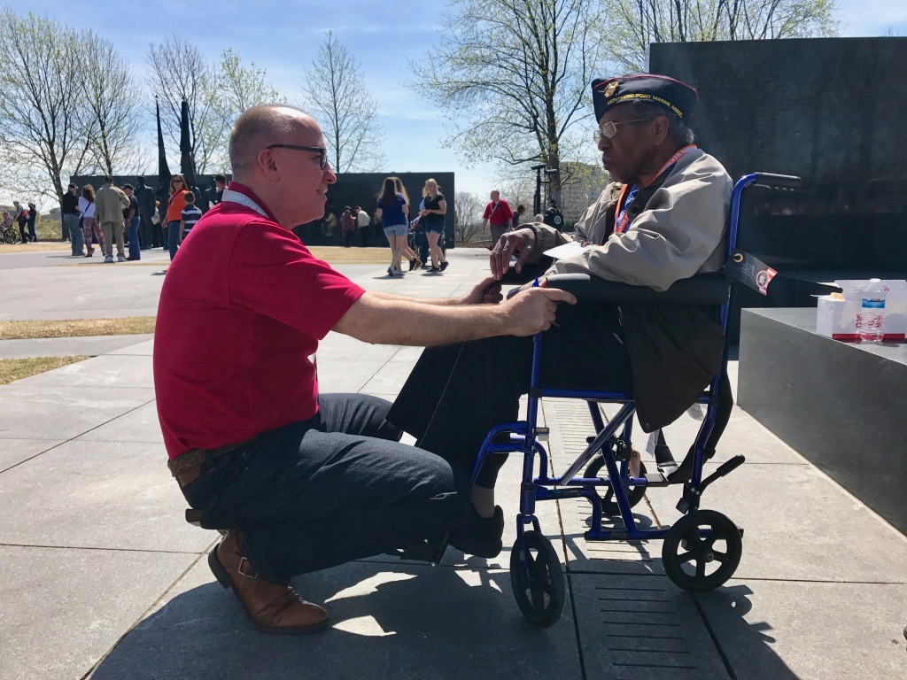 Eddie visiting with a WWII veteran on HonorAir Knoxville Flight