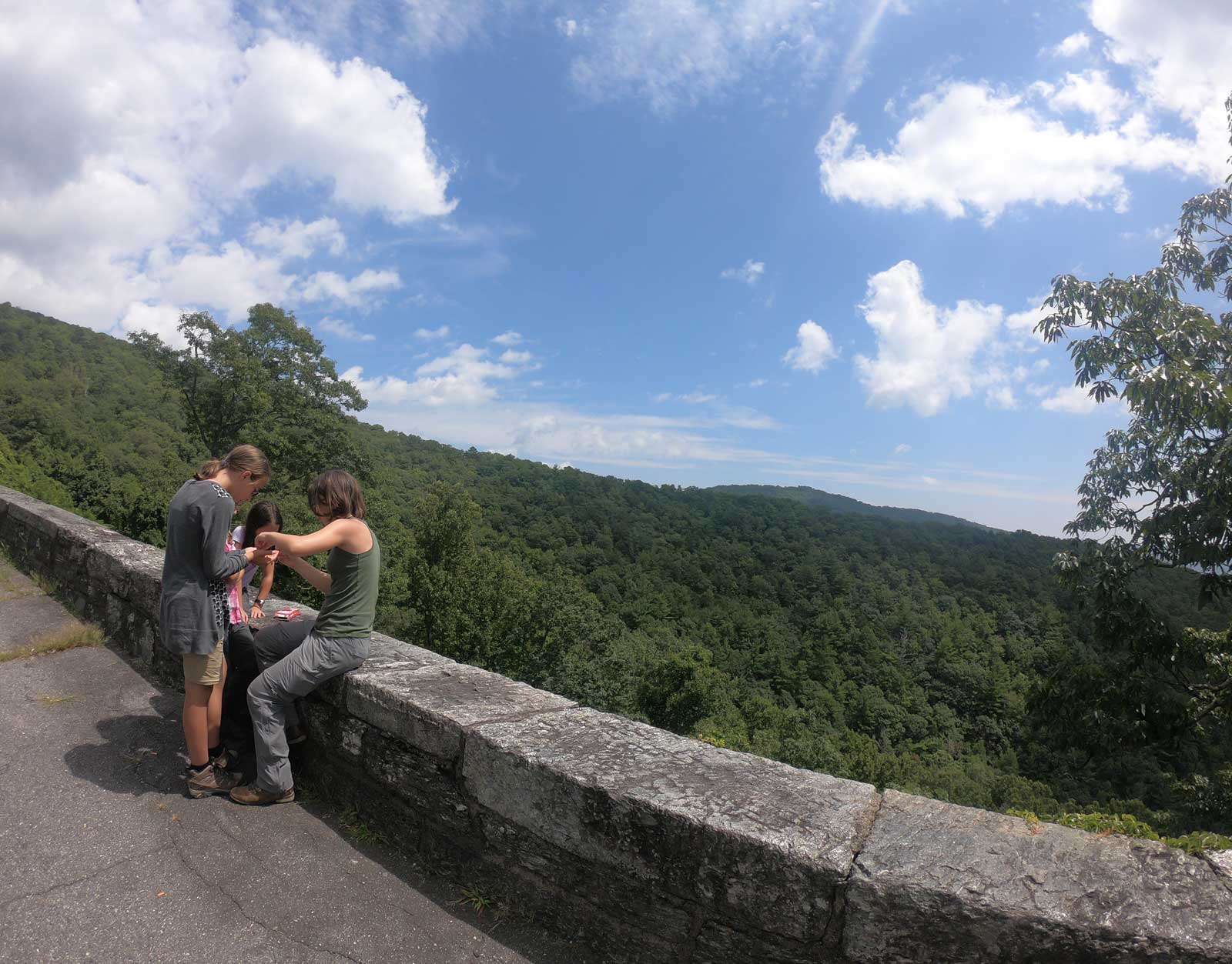 Photo of three girls at an overlook on the Blue Ridge Parkway near Black Mountain Campground.