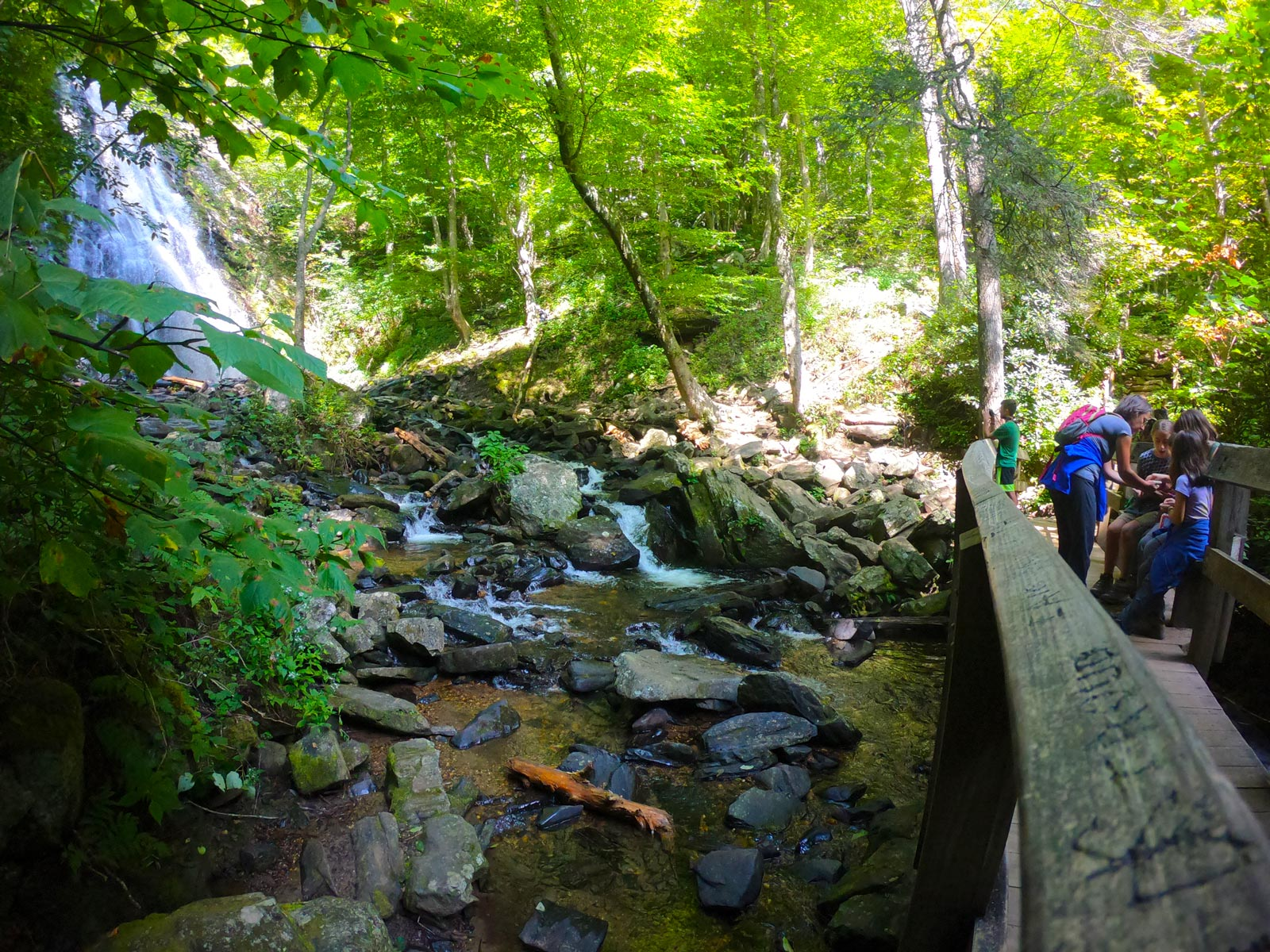 Family resting at Crabtree Falls on the Blue Ridge Parkway