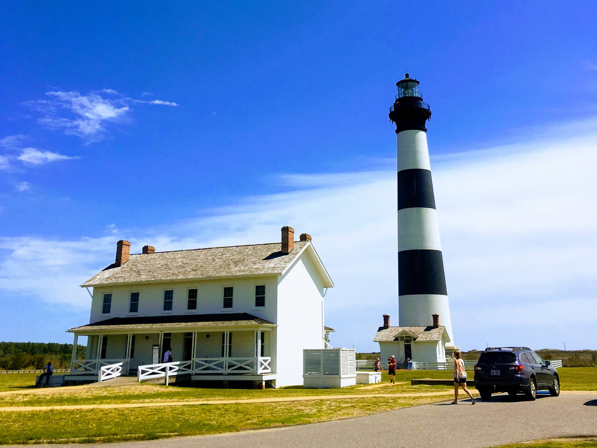Bodie Island Lighthouse on a sunny day with blue skies at the Outer Banks, North Carolina