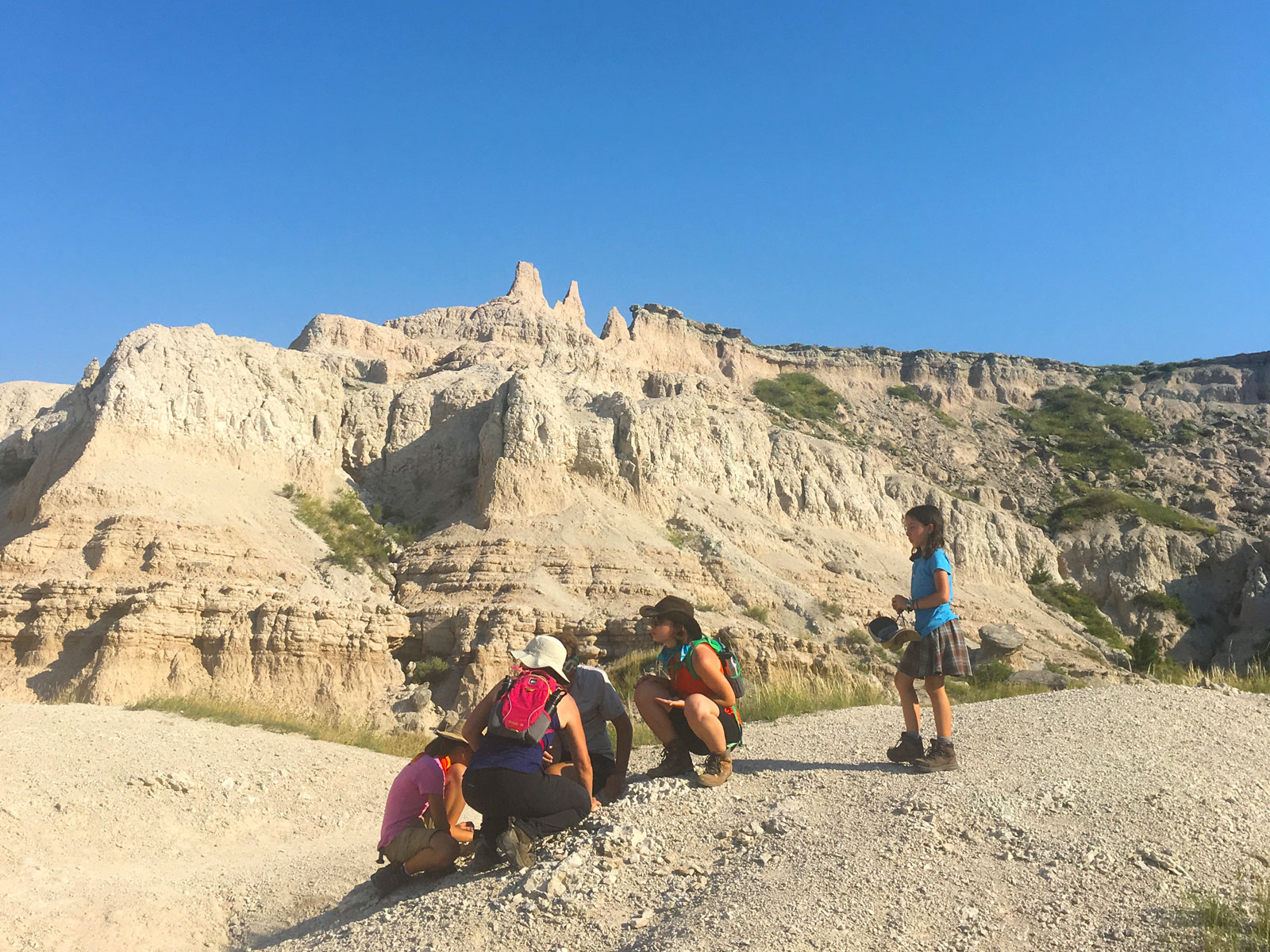 Family looking for fossils on the Notch Trail in the Badlands National Park in South Dakota