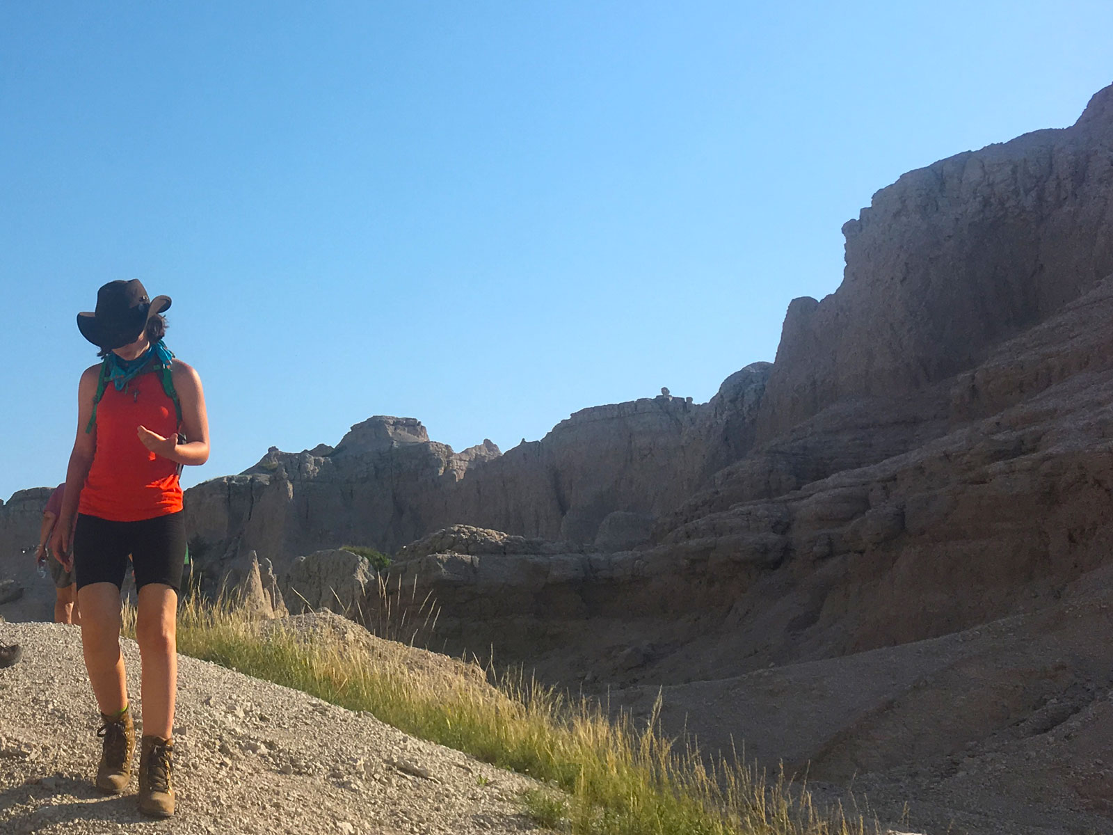 Girl wearing a cowboy hat hiking the Notch Trail in Badlands National Park, South Dakota