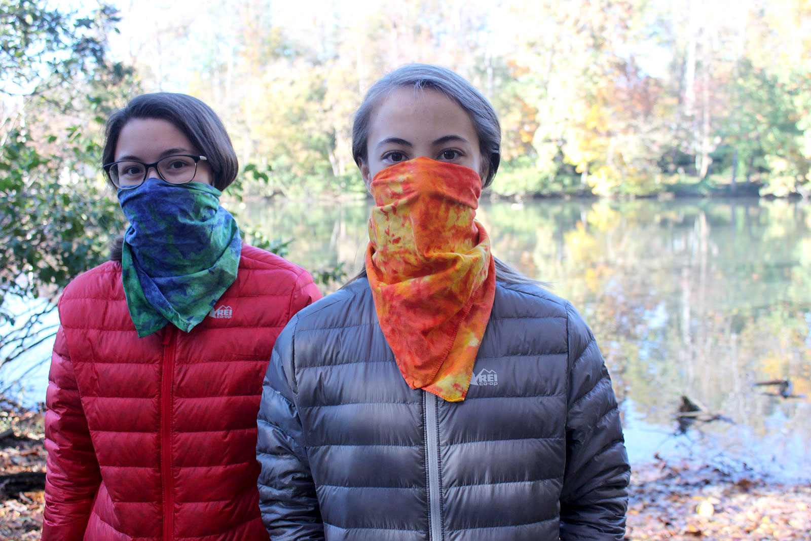 Photo of two girls wearing scarfs while wearing REI 650 Down Jackets.