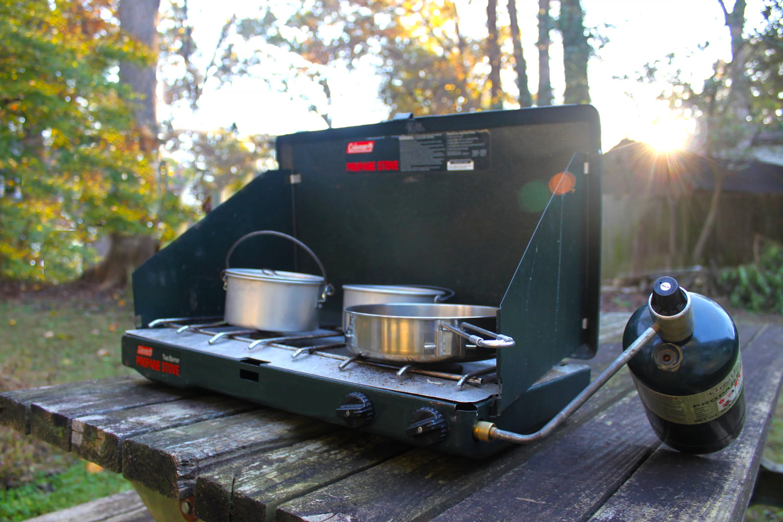 Photo of a Coleman 2-Burner Stove on a picnic bench