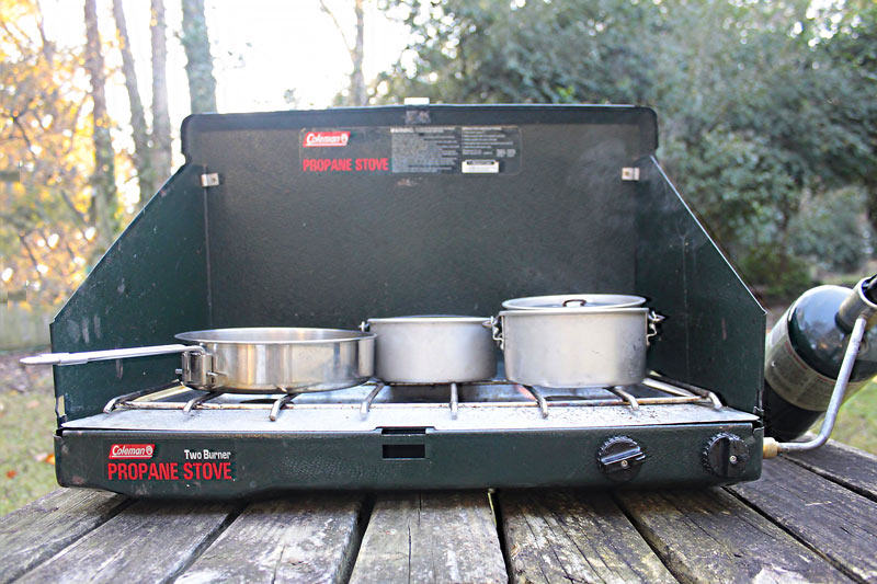 Photo of a Coleman 2-burner camp stove on a wooden table