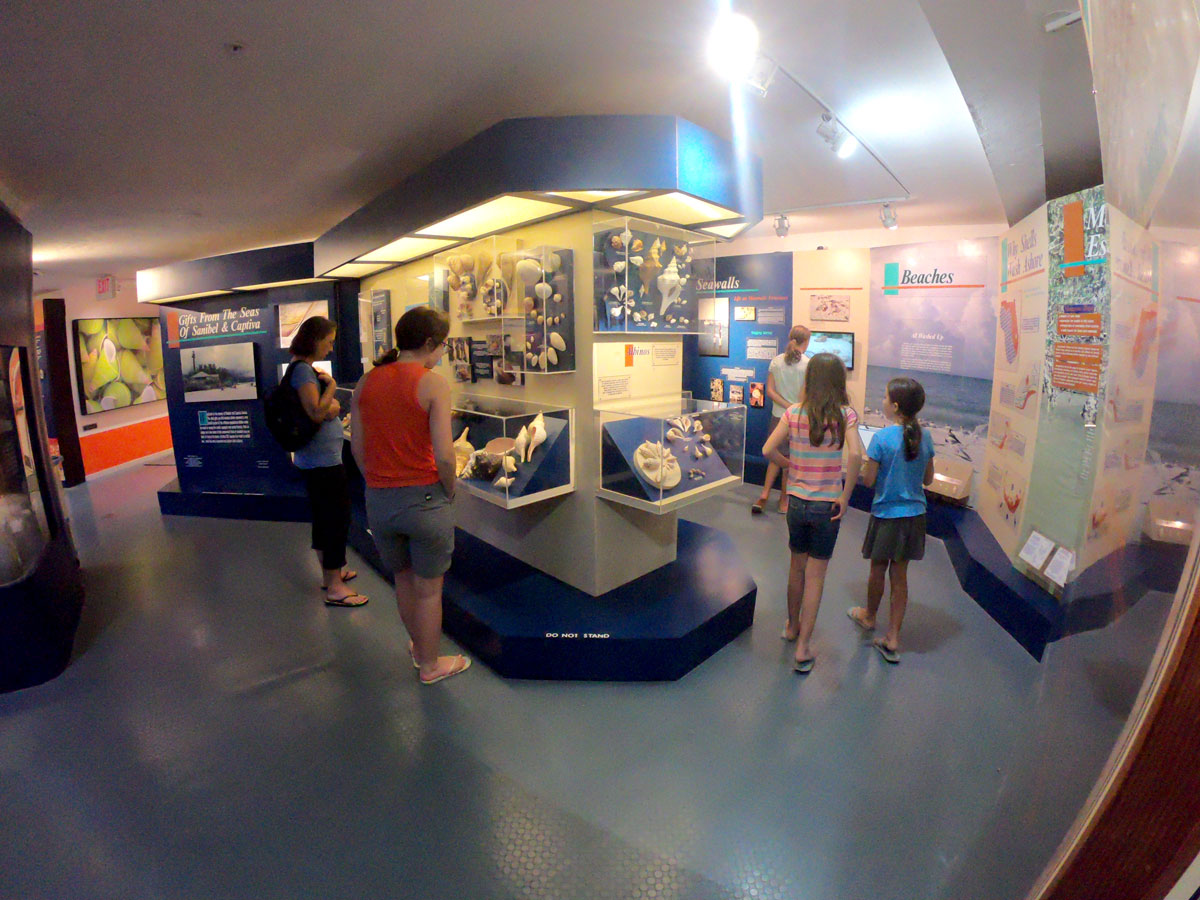 Mother and four daughers looking at exhibits at the Bailey-Matthews National Shell Museum, Sanibel Island, FL