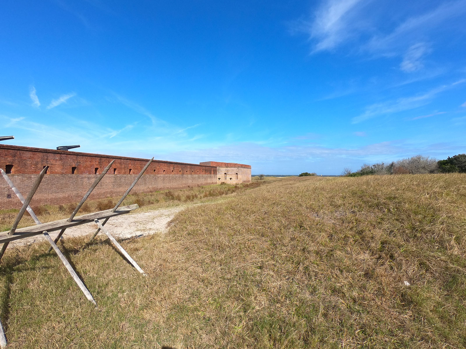Expansive view of exterior brick walls of historic Fort Clinch