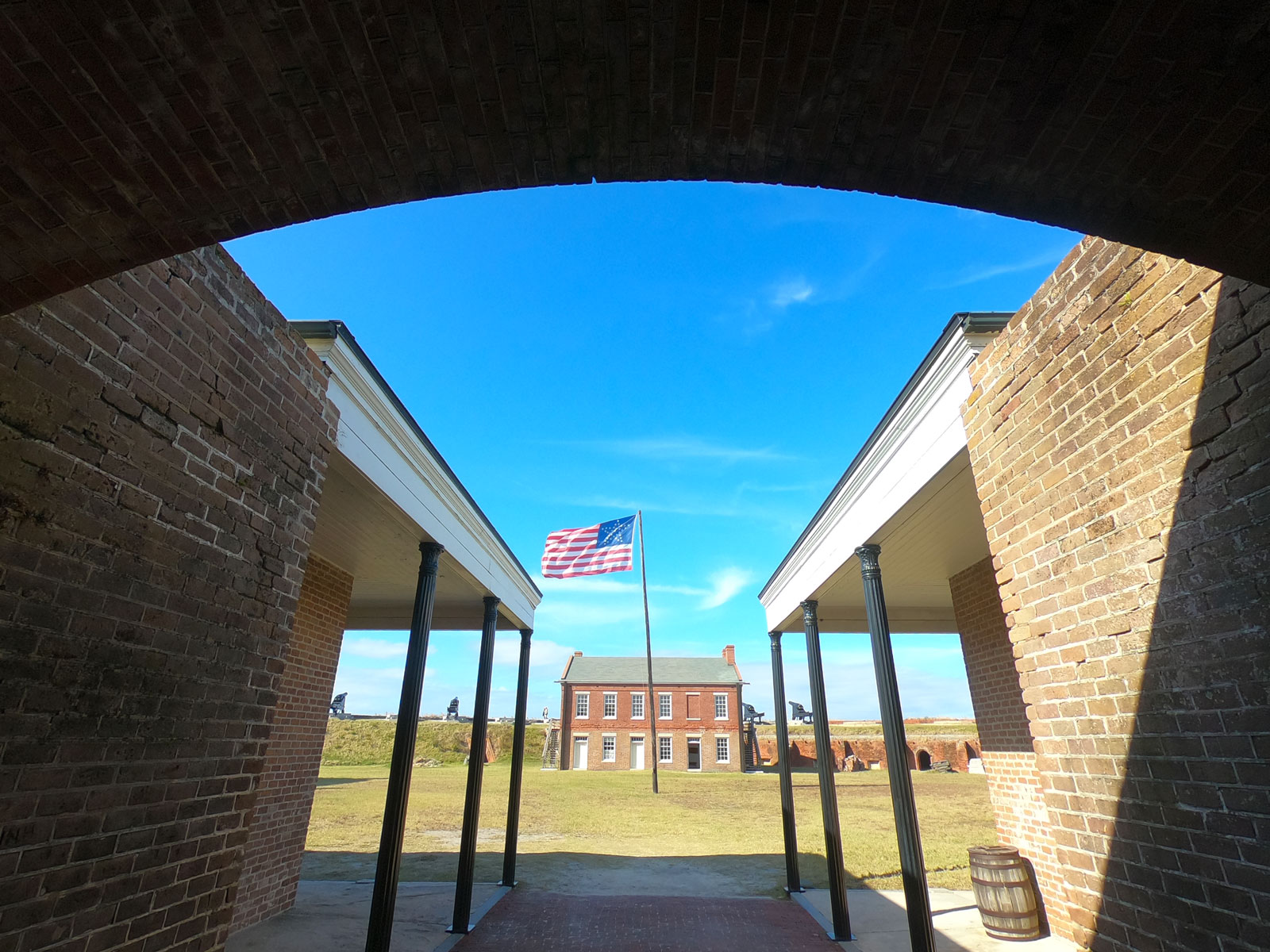 American flag flying in front of outbuilding in the courtyard of historic Fort Clinch, Florida