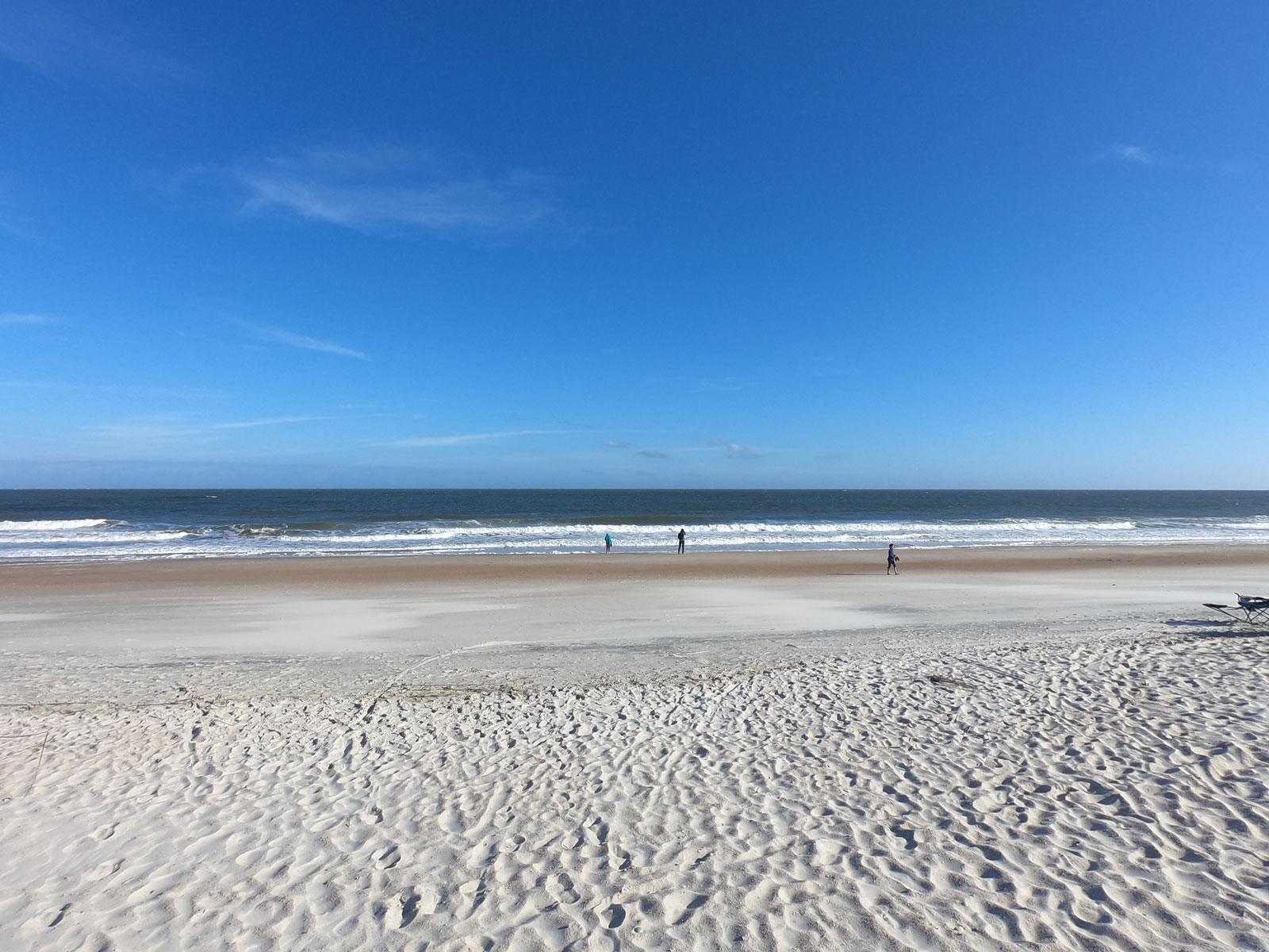 Wide, sandy white beach and bright blue sky at Fort Clinch State Park, Florida