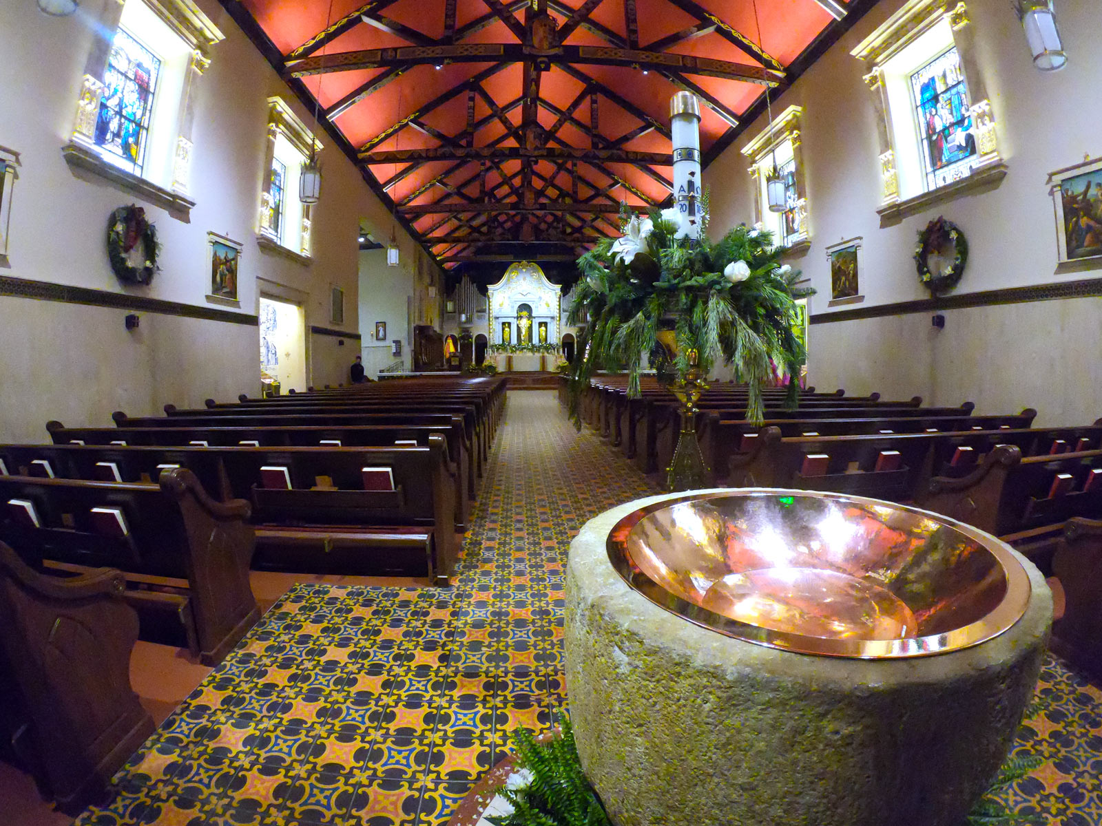 Indoor sanctuary of Cathedral Basilica of Saint Augustine with Spanish architecture and wooden pew in Saint Augustine, Florida