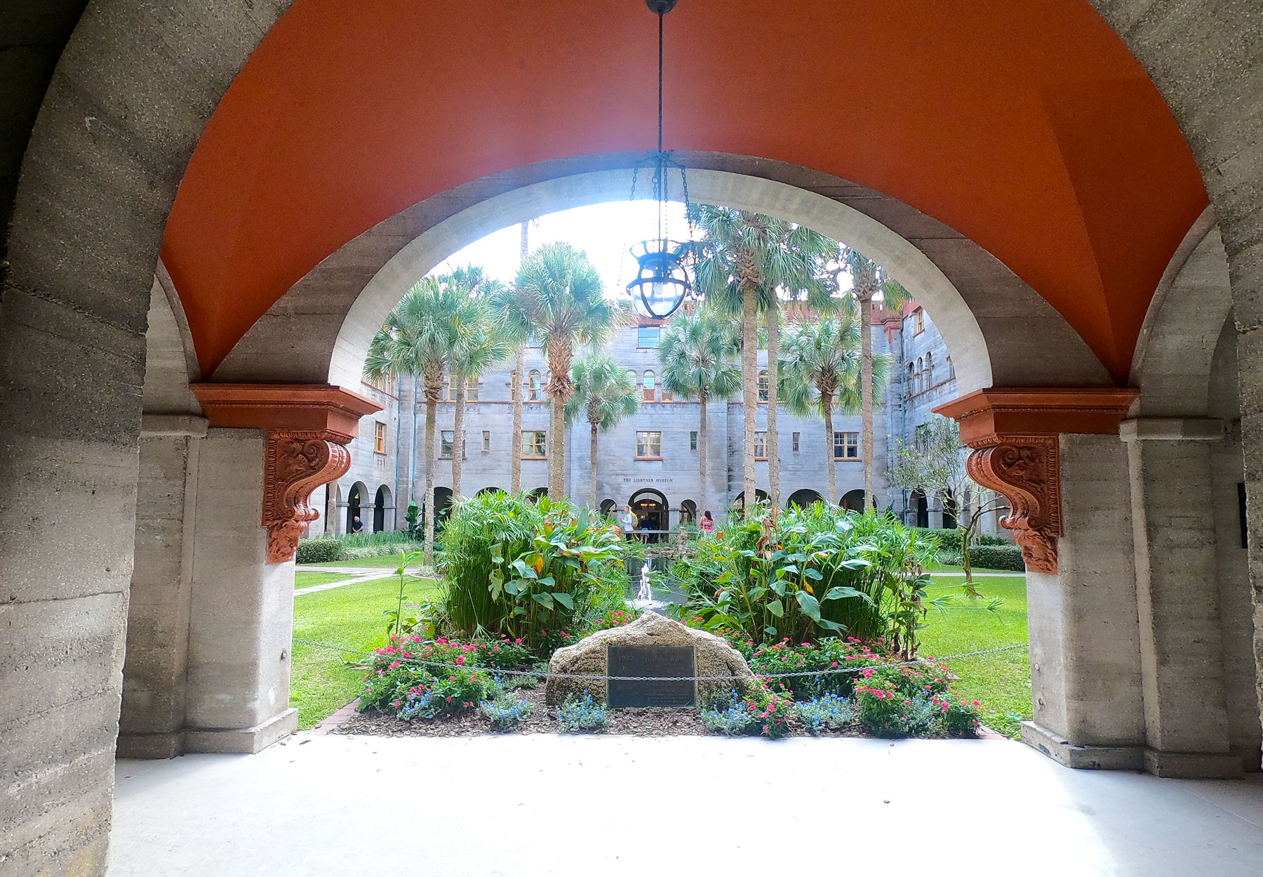 Arched brick walkway entrance to Lightner Museum courtyard in Saint Augustine, Florida