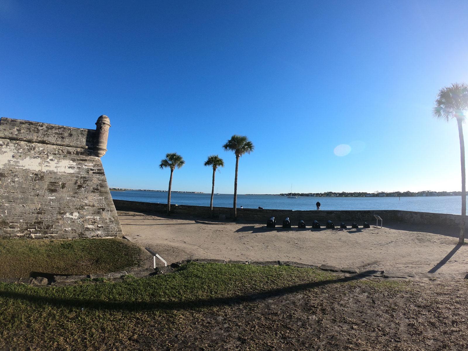 Corner of Fort Castillo de San Marcos National Monument under a blue sky in Saint Augustine, Florida