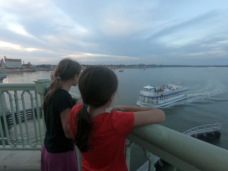 Two girls on Bridge of Lions watching a boat in the Matanzas River near St.Augustine, Florida