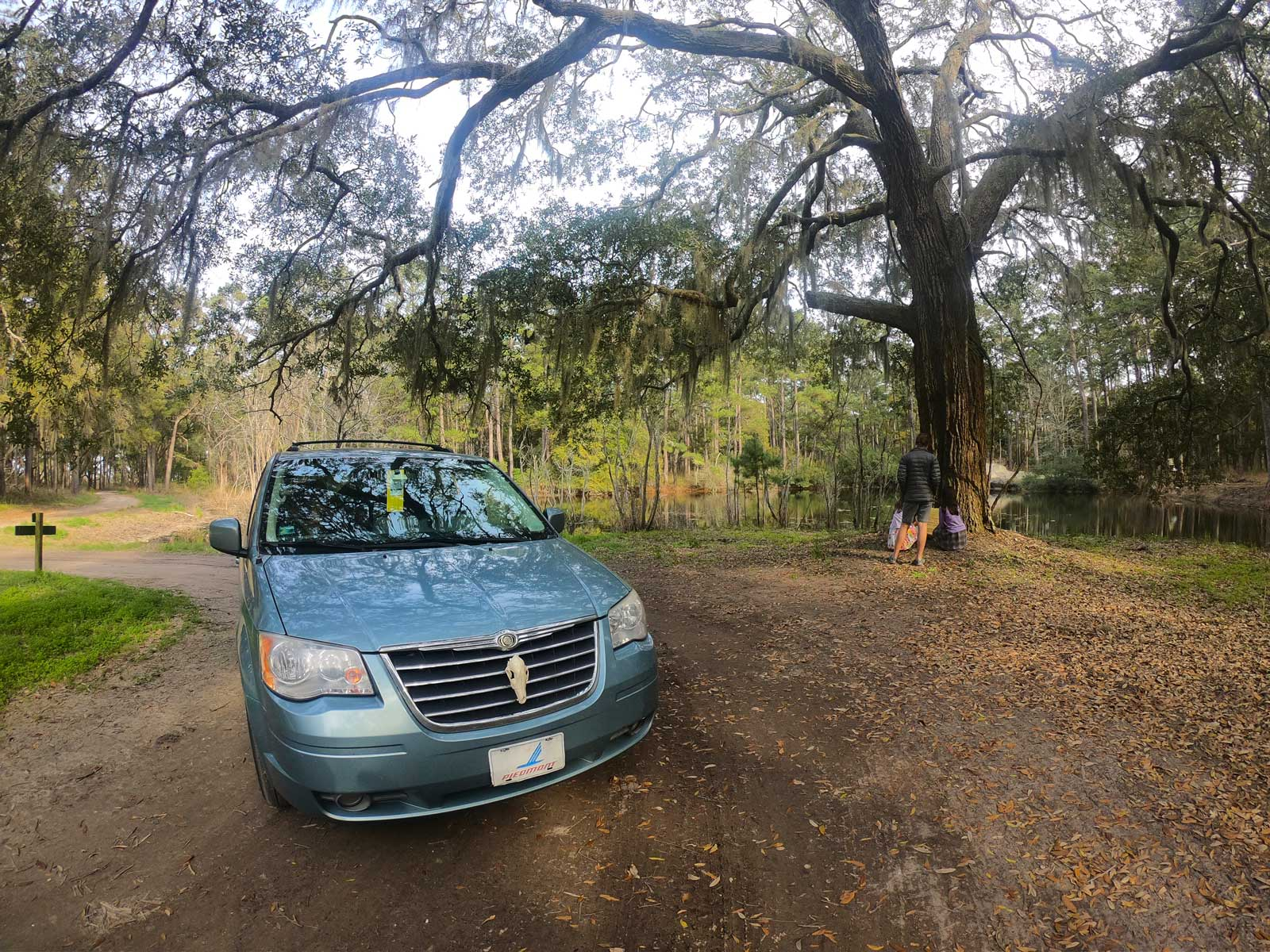 Van parked under a large live oak near Botany Bay pond at the Botany Bay Plantation, Edisto Island, SC