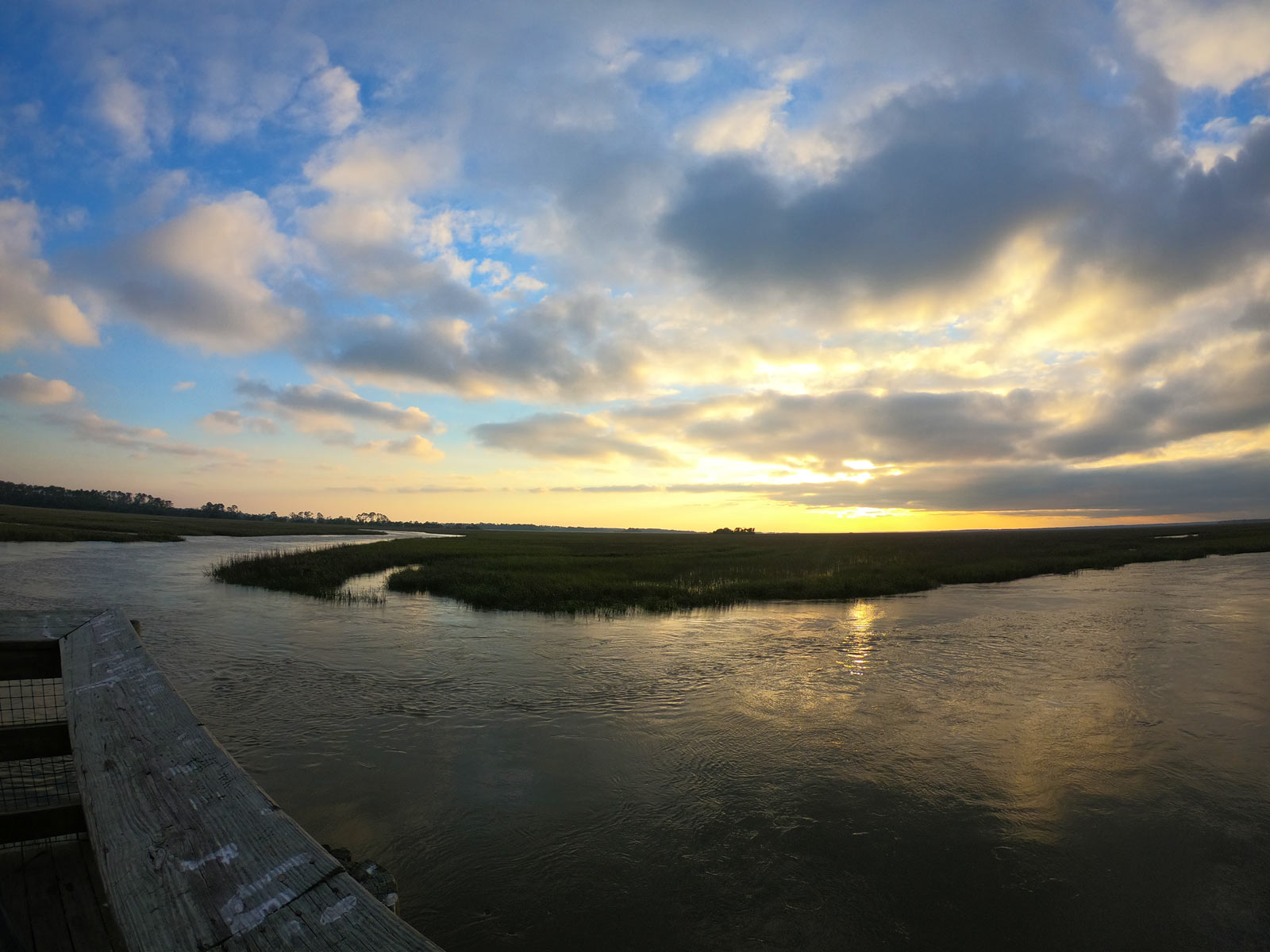 Sunset over the salt marshes at the Marshwalk Boardwalk on Hunting Island State Park, SC Trail deck
