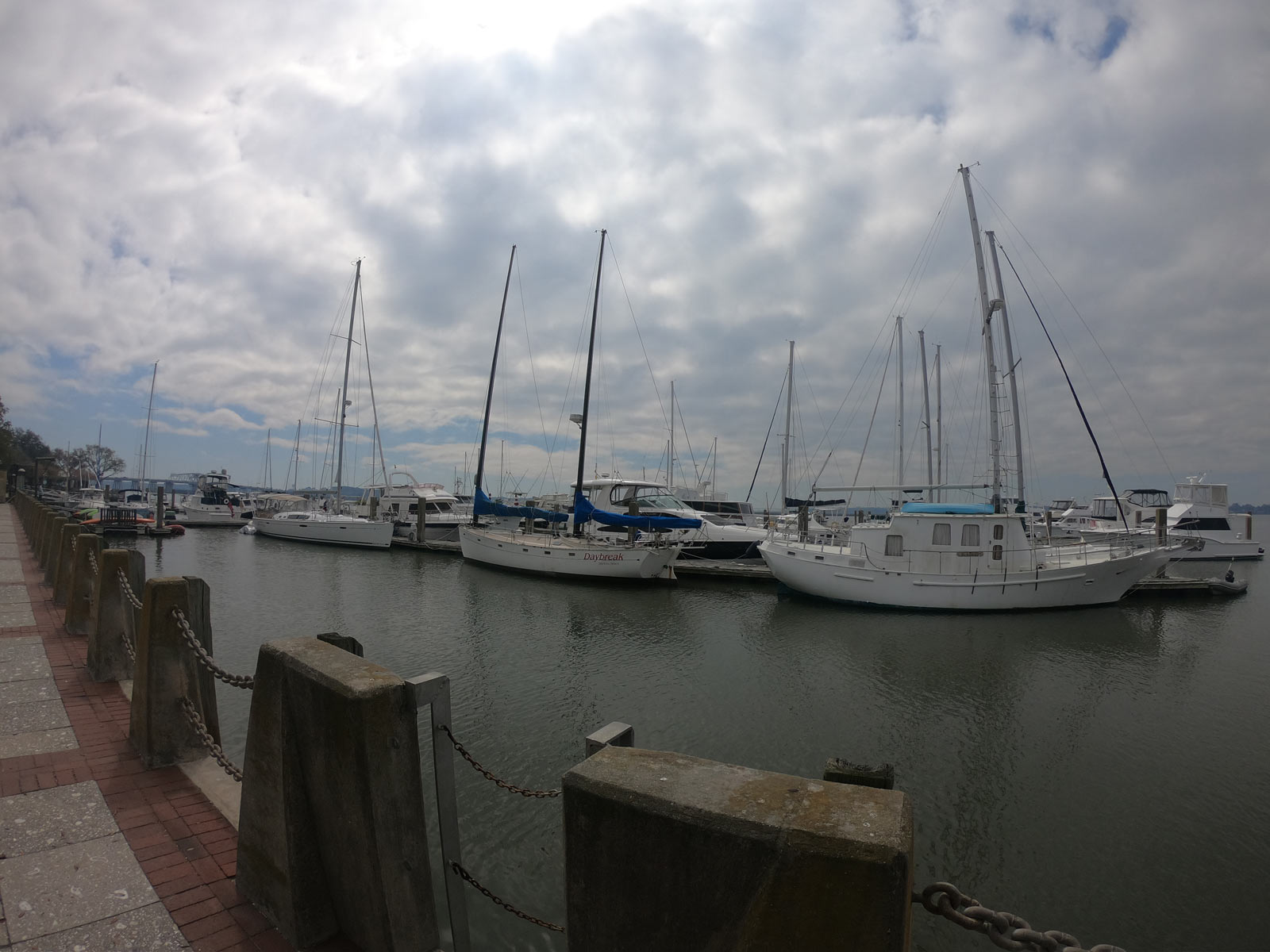 Beaufort waterfront with ships in the harbor under clouds