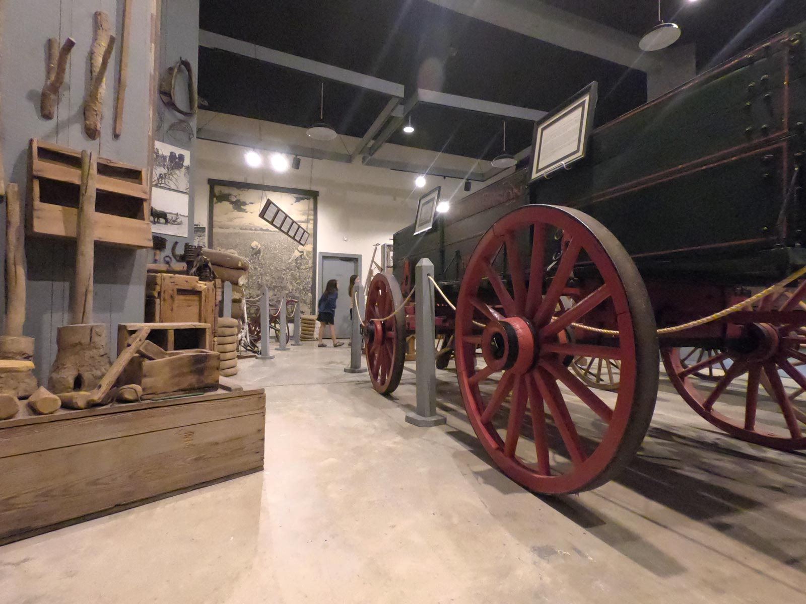 Indoor exhibit of tools and wagons for tobacco farming at  the Tobacco Farm Life Museum, Kenly, North Carolina